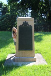 Henry's 5th Great Granddaughter standing at the monument honoring the Missouri 6th Infantry.